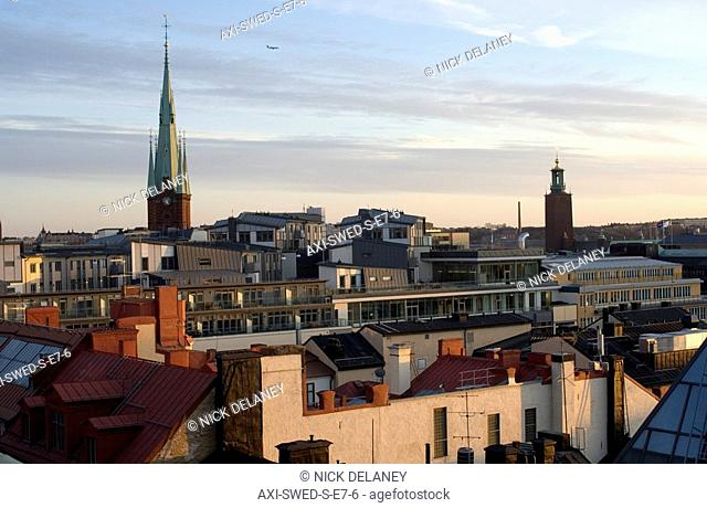 Cityscape with church spire at sunset