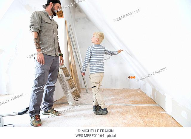 Father and son planning loft conversion