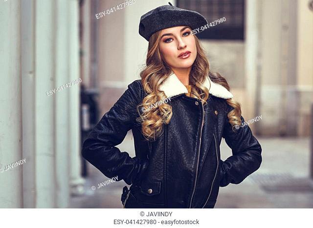 48d603313ba13 Blonde russian woman in urban background. Beautiful young girl wearing beret