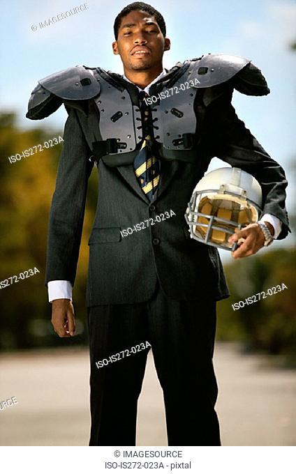 Businessman wearing american football uniform