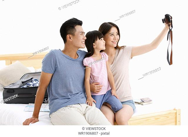 The happiness of a family of three in the photo