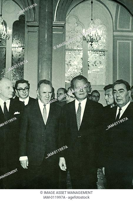 Left to right, front row: West German Foreign Minister Walter Scheel, Soviet Prime Minister Kosygin, Chancellor Willy Brandt
