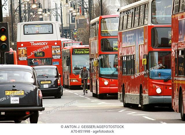 Double-decker red buses and taxis. London. England