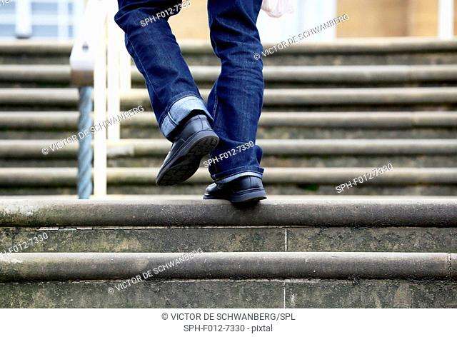 Person walking up steps