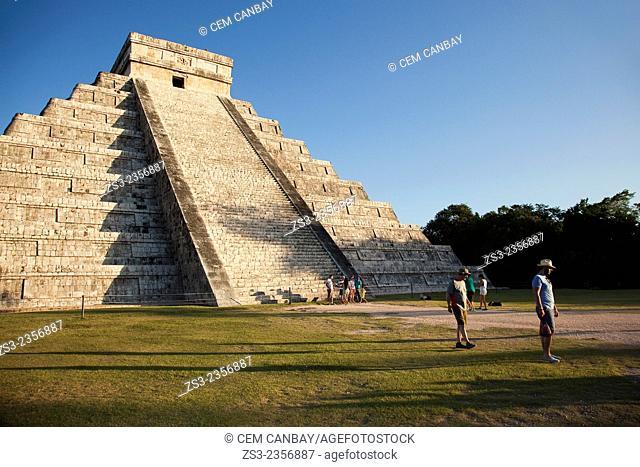 Tourist walking around the Pyramid of Kukulcan-El Castillo, Maya Archeological Site Chichen Itza, Yucatan Province, Mexico, Central America