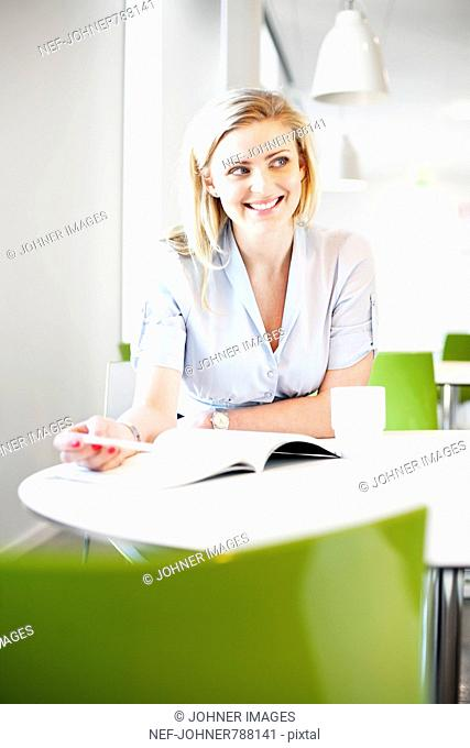 Blond woman by a table, Sweden