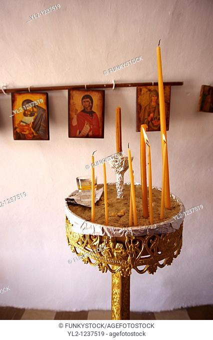 Interior of one of the 365 Greek Orthodox Chapels of Ios with religious icons  Cyclades Islands, Greece