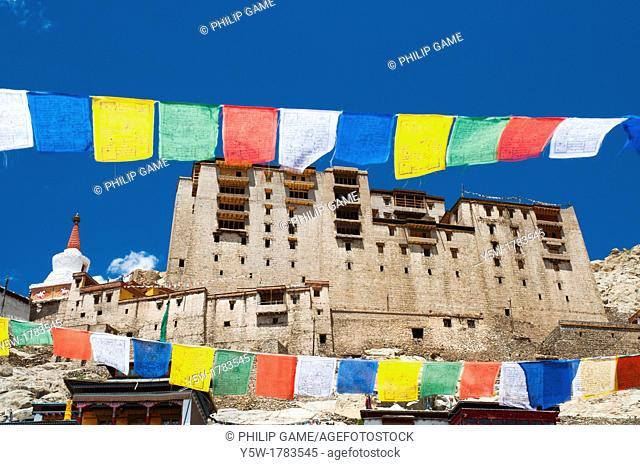 Seen between strings of Buddhist prayer flags, the historic Tibetan-style palace dominates the town of Leh, capital of Ladakh, India's 'Little Tibet'