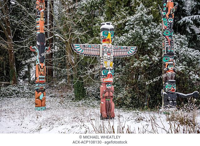 West coast totem poles with dusting of Winter snow, Brockton Point, Stanley Park, Vancouver, British Columbia, Canada