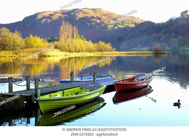 Boats moored on Grasmere, Lake District National Park, Cumbria, England, UK