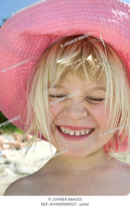 A girl in a pink sun hat, Sweden
