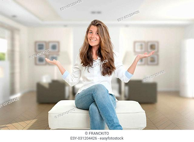 Happy young woman sitting at home