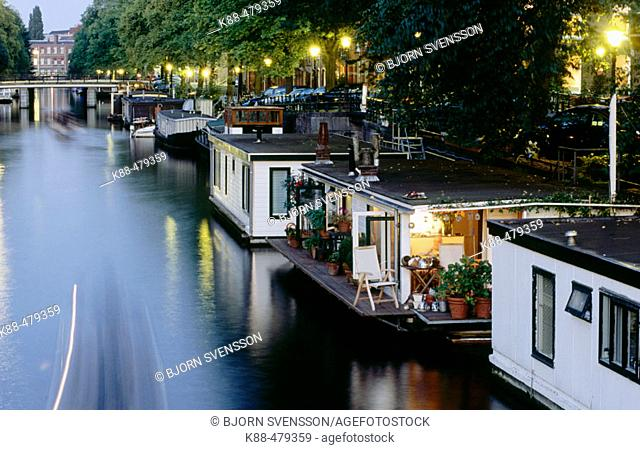 Houseboats by night, Nieuwe Keizersgracht, Amsterdam. Holland