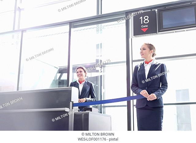 Two stewardesses at departure gate