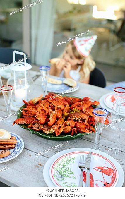 Bowl of crayfish on table