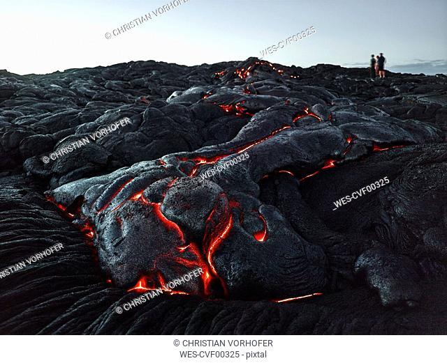 Hawaii, Big Island, Hawai'i Volcanoes National Park, tourists standing on lava field
