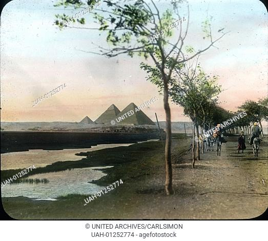 Egypt, Road to Giza and a view to the pyramids, image date: circa 1910. Carl Simon Archive