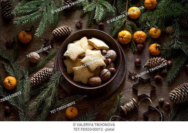 Star shape Christmas cookies and pine fronds