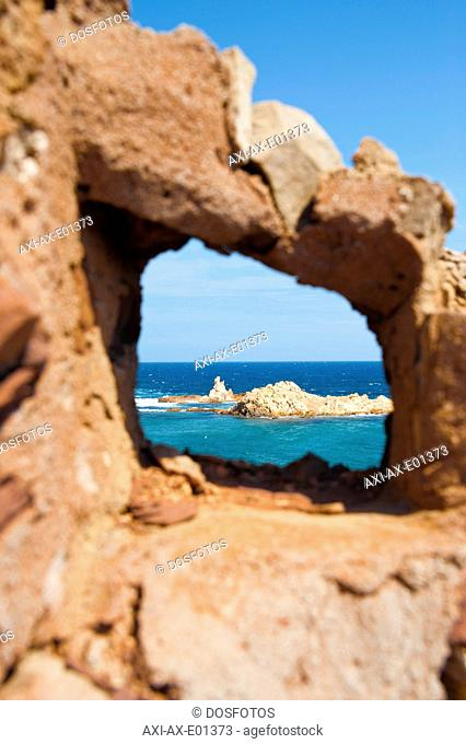 Cala Pregonda as seen through the rocksMenorca, Balearic Islands, Spain