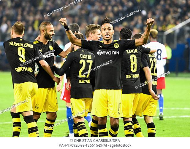 Dortmund's Pierre-Emerick Aubameyang (C) celebrates his goal - the second of the game - with teammates during the German Bundesliga soccer match between...