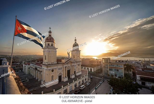 Cuban flag over Plaza de la Catedral at sunset, Santiago de Cuba, Cuba