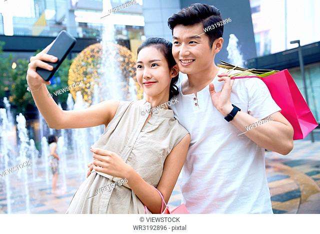 Young couples to use mobile phones
