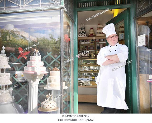Baker standing in cake shop