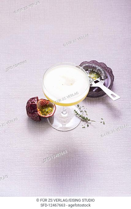Passion fruit mocktail with thyme (alcohol-free)