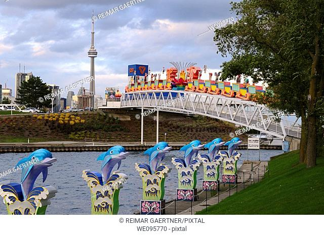 Toronto skyline at dusk with CN Tower and Chinese Lantern Festival displays from Ontario Place