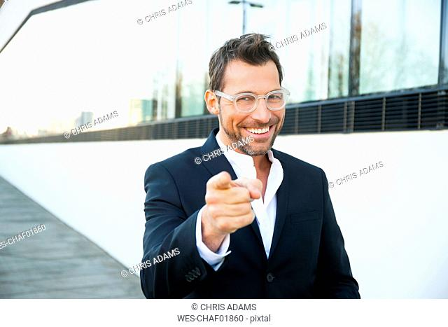 Portrait of confident businessman outdoors pointing his finger