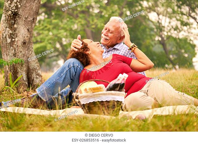 Senior couple, old man and woman in park on weekend activity. Grandpa and grandma doing picnic in wood. Concept of retirement age and love