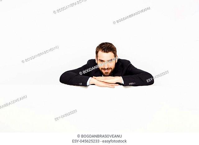 elegant businessman showing a white panel under him