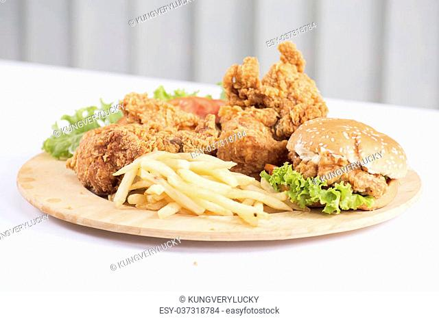 Fried chicken, burger and french fries on the Plate