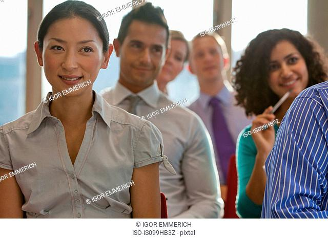 Office workers sitting in meeting room