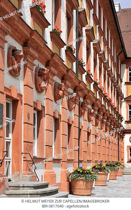 Façade with ancient busts of emperors, gods and goddesses at the former Altes Schloss castle, 18th century, now tax office, Bayreuth, Bavaria, Germany