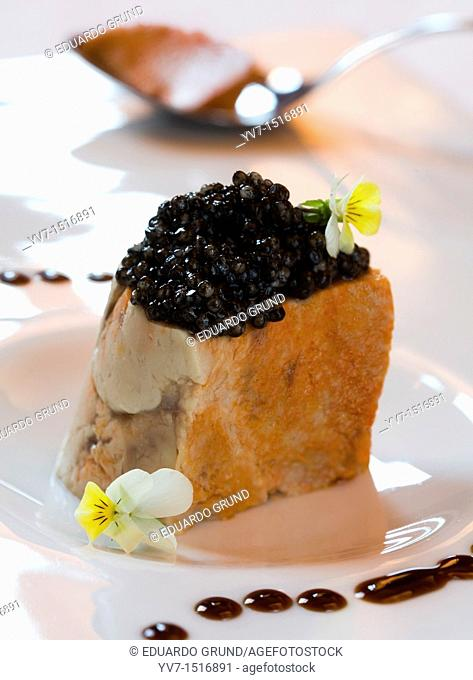 Foie monkfish with caviar sauce, mustard and white violets