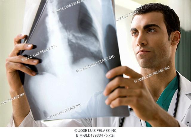Hispanic doctor viewing x-ray