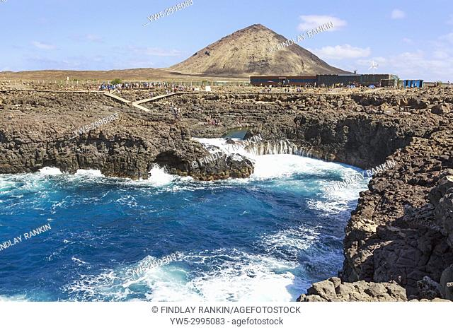 Naturally occurring swimming pool in the rocks at Baracona, beside Terra Boa desert and Monte Leste mountain, Sal, Salinas, Cape Verde, Africa