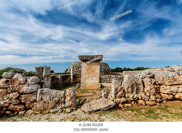 View of taula amongst ancient Talayotic ruins, Menorca, Spain