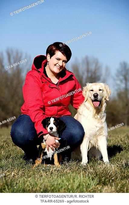 woman and 2 dogs