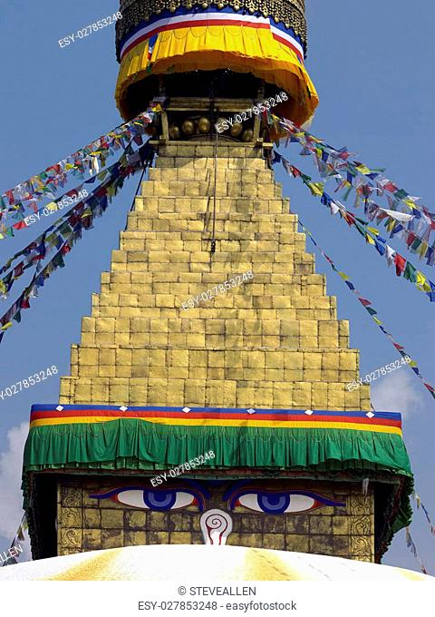 The all-seeing eyes of Buddha on the Boudhanath Stupa in Kathmandu in Nepal