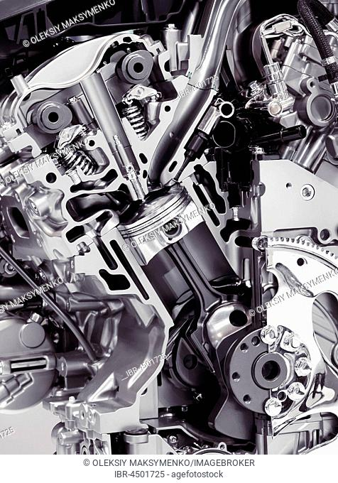 Closeup cross section of 2017 Buick Lacrosse 3.6L V6 VVT DI 310HP car engine showing the cylinder, piston and valves