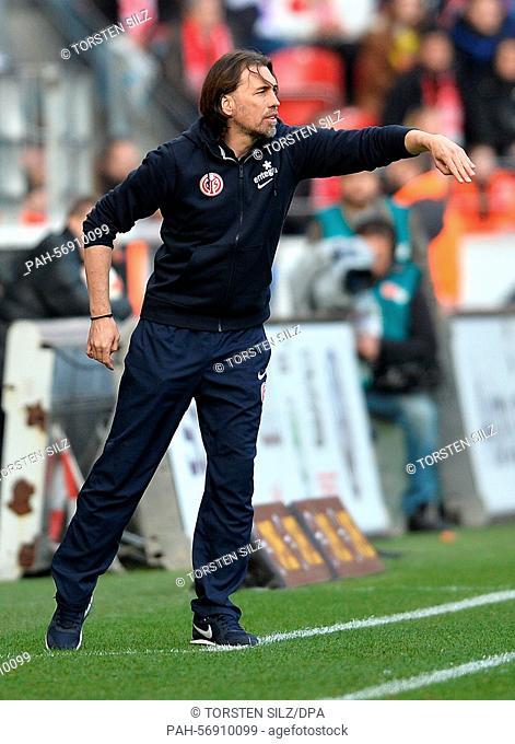 Mainz's coach Martin Schmidt gestures during the German Bundesliga soccer match between 1. FSV Mainz 05 and VfL Wolfsburg in theCoface Arena inMainz, Germany