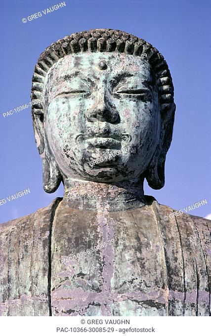 Maui, Lahaina, closeup of Amitabha Buddha statue, front view, blue sky bkgd