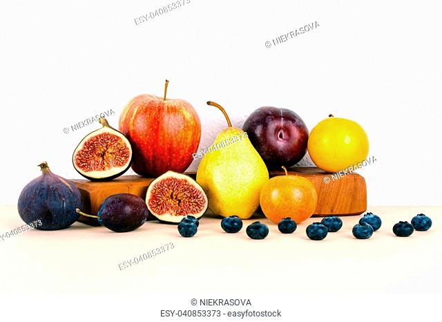 Organic autumn seasonal fruits. Diet and healthy food concept