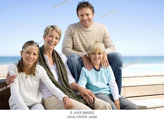 Family sitting near swimming pool