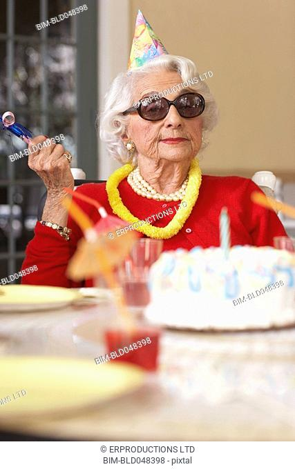 Senior woman with birthday cake