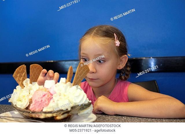 Six year old girl with a Banana split ice cream