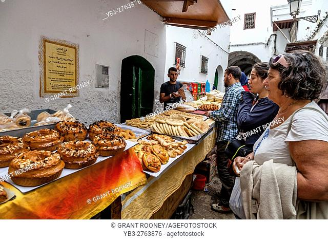 Local People and Tourists Queue Up To Buy Bread and Pastries From A Bakery In The Medina, Tetouan, Morocco