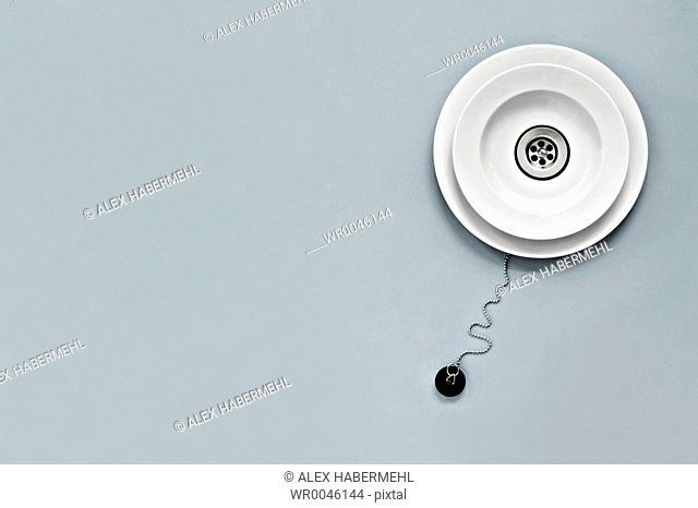 High angle view of washbowl with plug